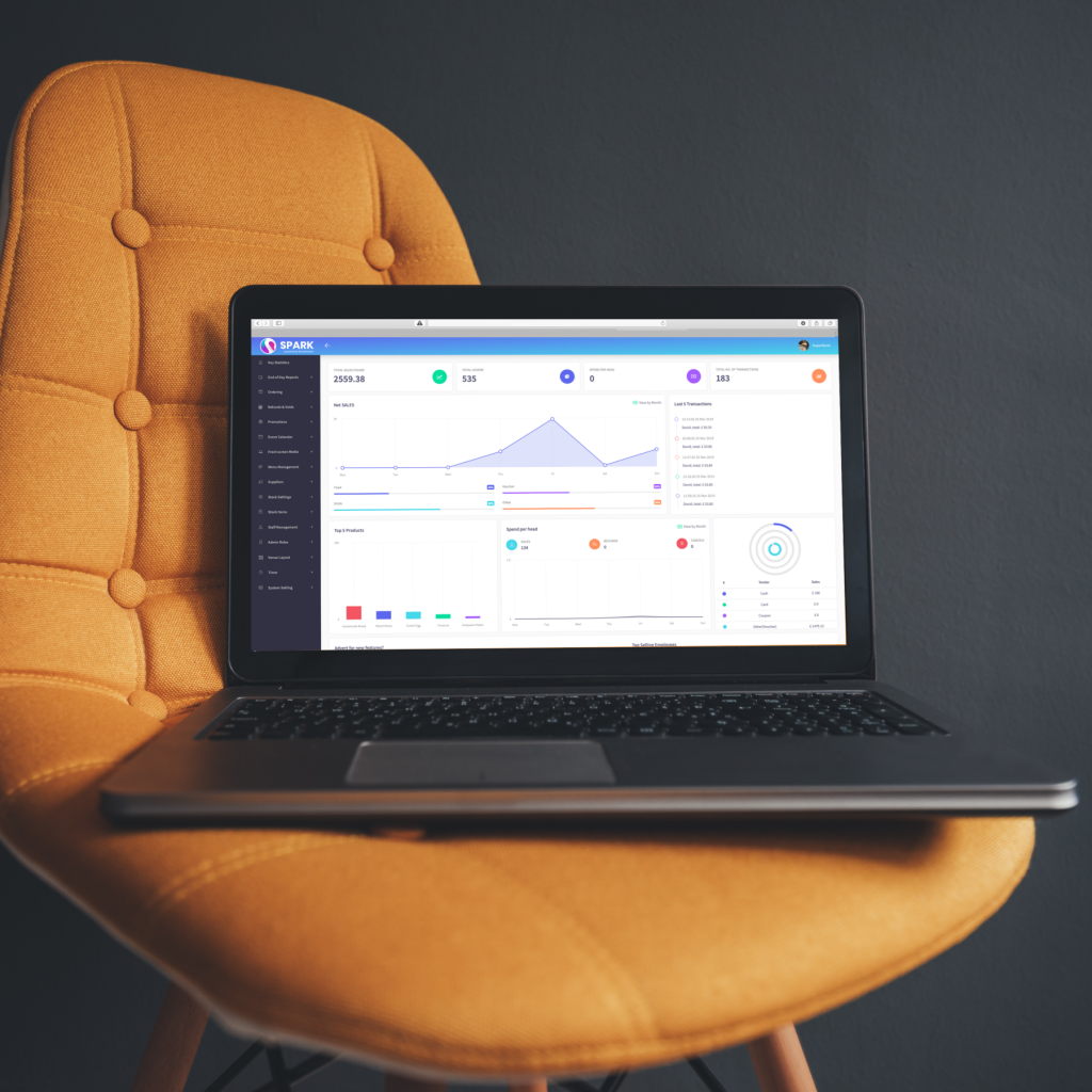 image of a laptop on a chair. The screen is displaying the spark epos cloud office dashboard