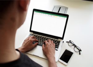 looking at spreadsheet on laptop